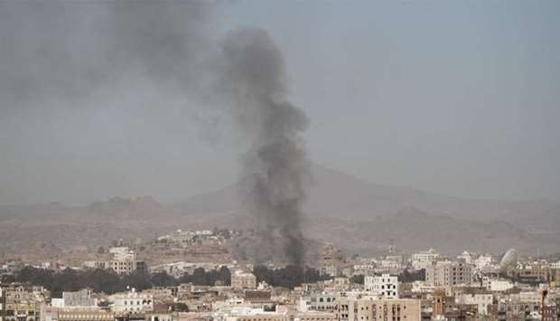 Smoke rises after an airstrike in  Yemen