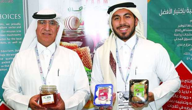 Dr Salem al-Naemi (left) and his son Nasser at their stall at Made in Qatar. PICTURES: Jayaram