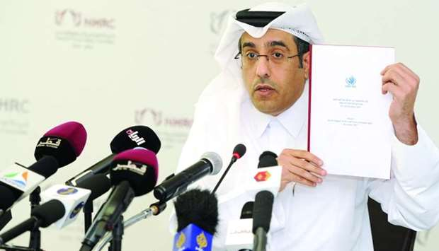 NHRC chairman Dr Ali bin Smaikh al-Marri displays a copy of the report submitted by the UN technical