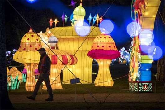 Visitors look at giant lanterns installed in the Foucaud Park in Gaillac, southwestern France