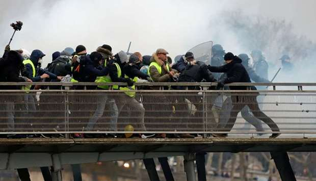 Former French boxing champion, Christophe Dettinger (R), is seen during clashes with French Gendarme