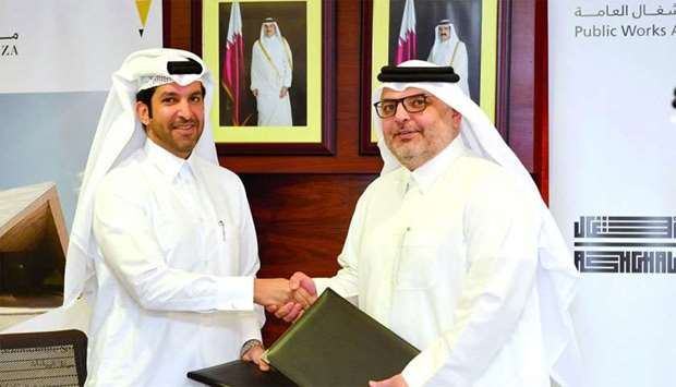 Meeza CEO engineer Ahmad Mohamed al-Kuwari and Ashghal president engineer Saad bin Ahmad al-Muhannad