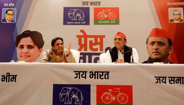 BSP chief Mayawati speaks as Akhilesh Yadav, chief of SP, looks on during a joint news conference to
