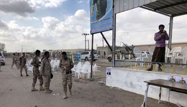 Soldiers inspect the scene of a January 10, 2019, Houthi drone attack at al-Anad air base, Lahaj pro