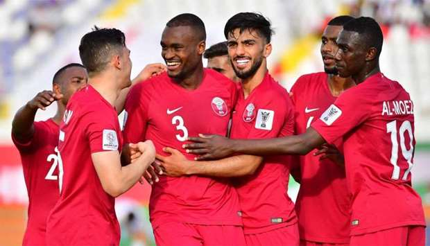 Qatar's defender AbdelKarim Hassan (3rd-L) celebrates after scoring a goal during the 2019 AFC Asian