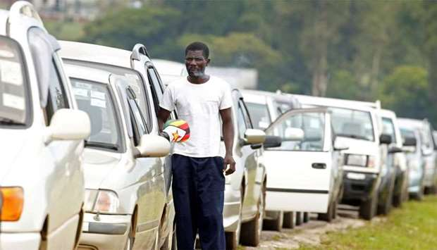 Motorists queue to buy petrol in Harare, Zimbabwe