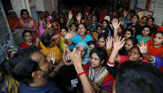 Garment workers shout as they protest for higher wages in Dhaka
