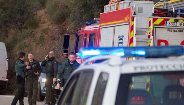 Spanish Civil Guard agents at the site where a two-year-old boy fell into a deep well shaft