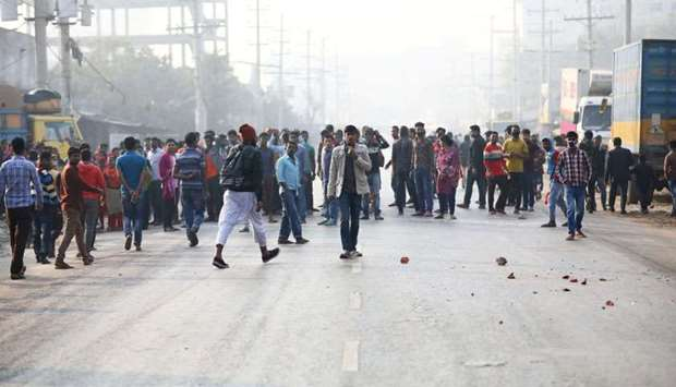 Garment workers block a road as they protest for higher wages at Ashulia, outskirt of Dhaka