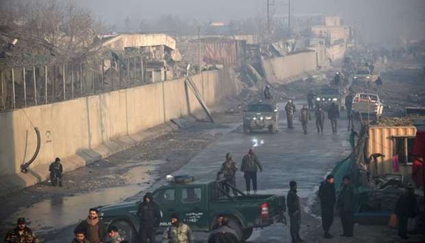 Afghan security forces gather at the site of a powerful truck bomb attack a day after it detonated n