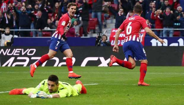 Atletico Madrid's Koke celebrates a goal with Antoine Griezmann that is later disallowed following a