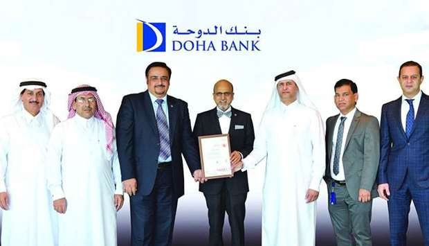 Doha Bank Group CEO Dr R Seetharaman and other dignitaries with the ISO 27001 Certification.