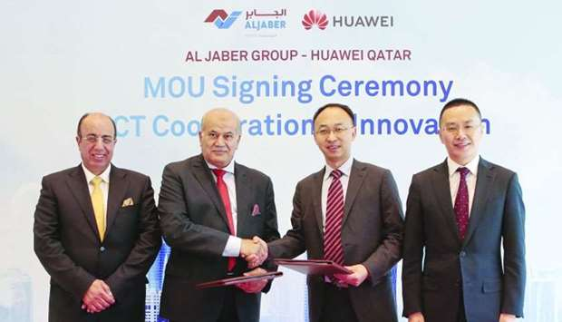 Huawei and Al Jaber Group officials