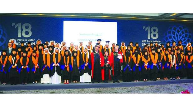 HEC Paris graduates pose for a group photo.