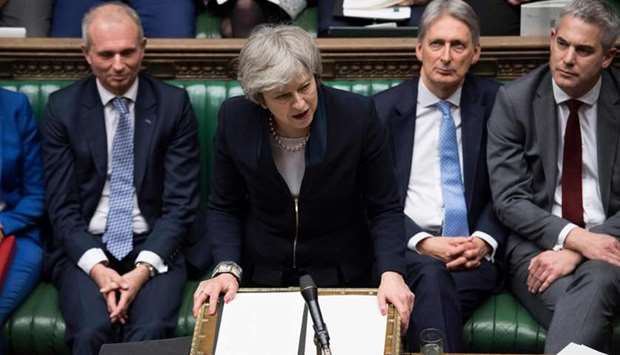Theresa May (C) making a statement in the House of Commons  directly after MPs rejected the governme