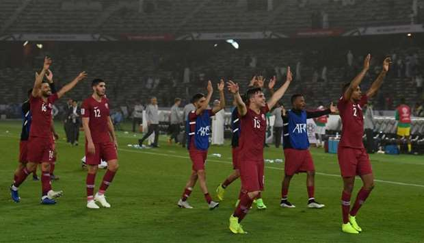 Qatar's players celebrate their win during the 2019 AFC Asian Cup group E football match between Sau