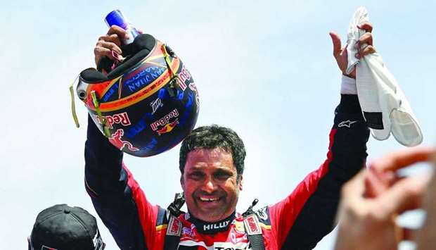 Toyota driver Nasser al-Attiyah of Qatar celebrates after winning the Dakar Rally 2019, at the end o