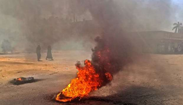 Sudanese protestors burn tires during an anti-government demonstration in the capital Khartoum