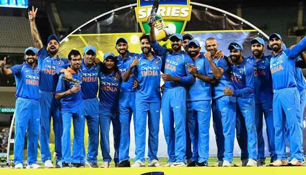 India's cricketers pose with their one-day international series trophy after defeating Australia at