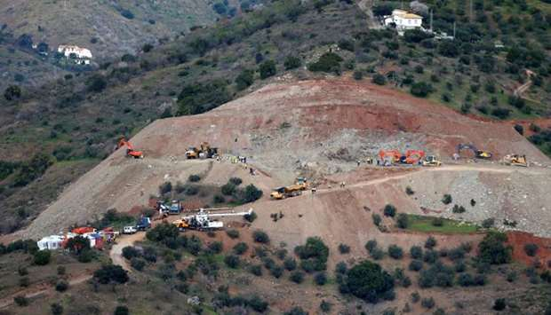 An idle drill is seen next to diggers and trucks removing sand at the area where Julen, a Spanish tw