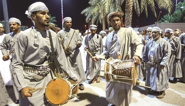 Omani men perform