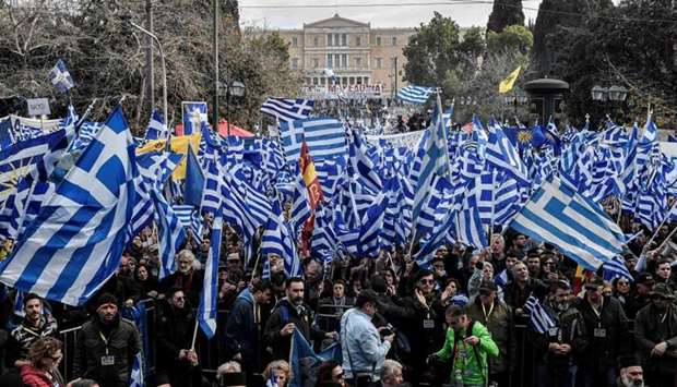 Protesters take part in a demonstration near the Greek Parliament against the agreement with Skopje