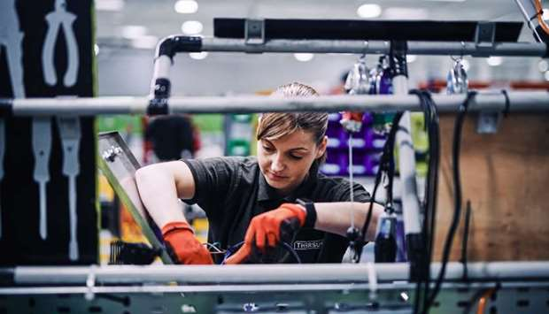 An employee works on the SafetyKleen units production line at the Tharsus Ltd factory in Blyth, the