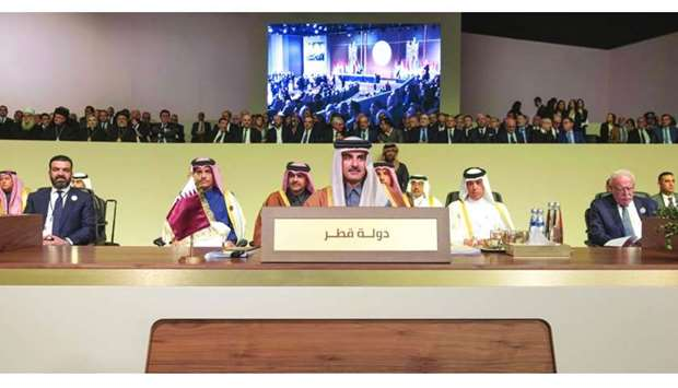 His Highness the Amir Sheikh Tamim bin Hamad al-Thani takes part in the opening session of the Summi