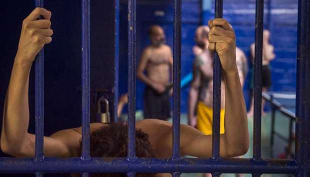 Foreign detainees are pictured behind bars at an immigration detention centre in Bangkok