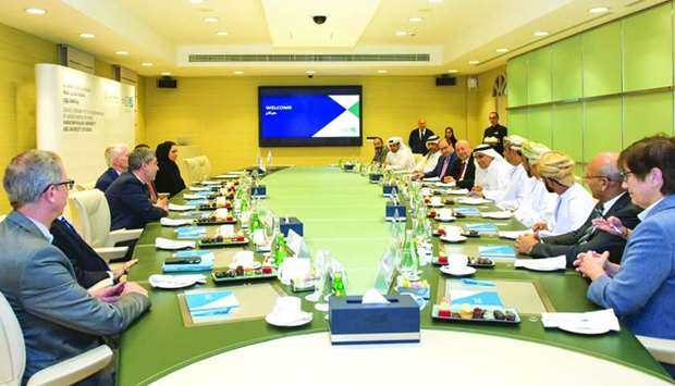Officials of HBKU and the University of Nizwa during a meeting.