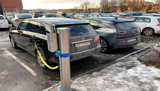 Electric cars are parked in Oslo, Norway