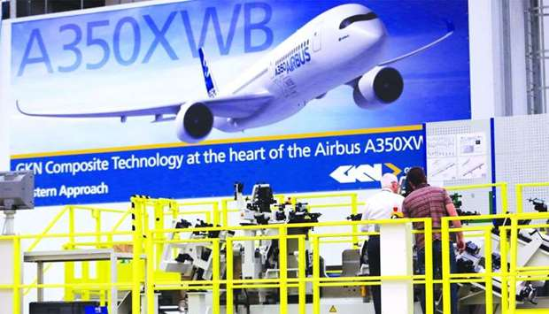 Employees inspect a jig used in the manufacturing of Airbus A350 aircraft at GKN's Aerospace factory