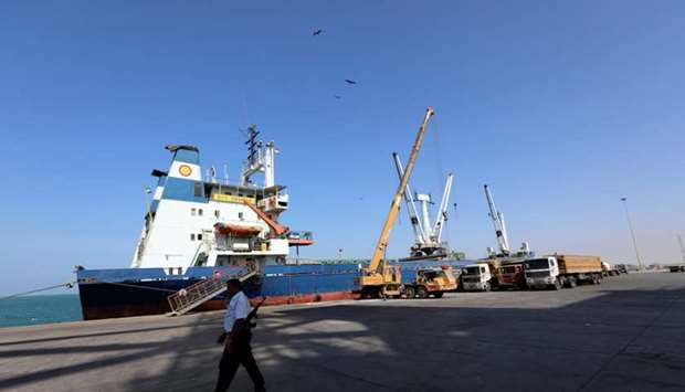 A coast guard walks past a ship docked at the Red Sea port of Hodeidah, Yemen.