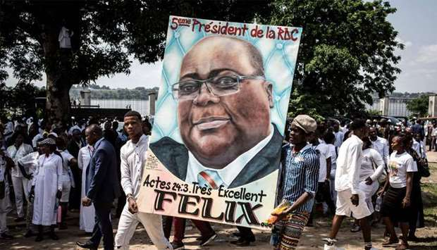 Supporters of new elected President of the Democratic Republic of Congo Felix Tshisekedi hold his po