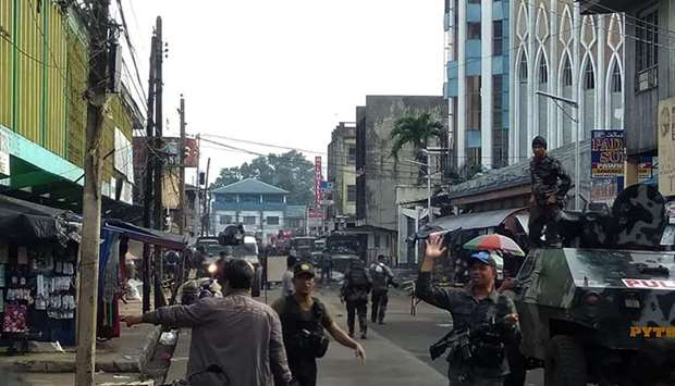 Soldiers guarding cathedral in Jolo after the explosions.