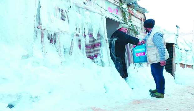 QC's assistance includes the distribution of winter needs and providing urgent medical services.