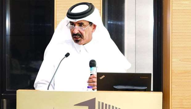 Al-Kuwari delivering a presentation in a seminar titled 'Importance of Maximising the Private Sector
