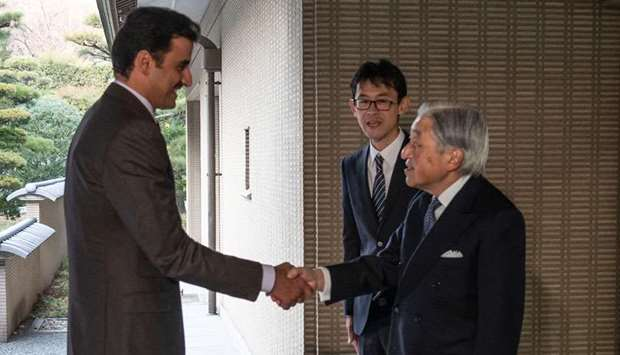 His Highness the Amir Sheikh Tamim bin Hamad Al-Thani shakes hand with Japan's Emperor Akihito.