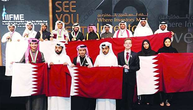 The victorious Qatari innovators and officials.