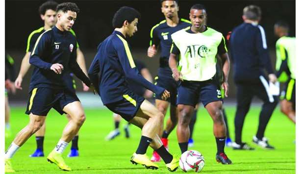 Qatar players take part in a training session ahead of their Asian Cup final against Japan on Friday