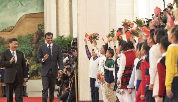 Children give a rousing welcome to the Amir and the Chinese President Xi Jinping as they arrive at t