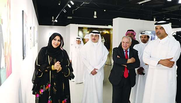 Kuwaiti artist Dr Iman al-Shammari briefs Katara officials and other dignitaries during a tour of th