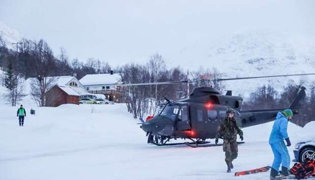 A military helicopter and rescue workers are seen in Tamokdalen, Norway