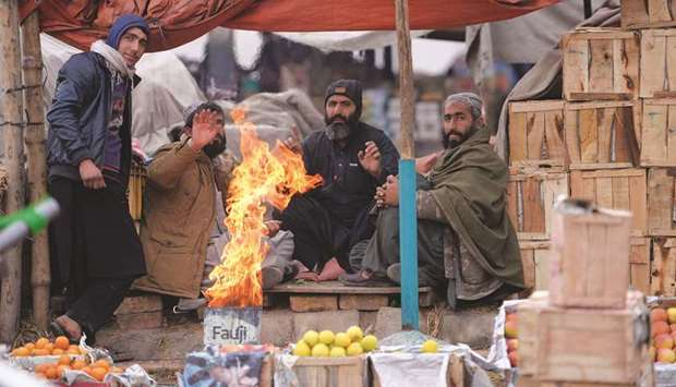 Vendors heat up around a fire