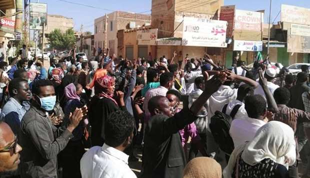 Sudanese protesters chant slogans during an anti-government demonstration in the capital Khartoum.