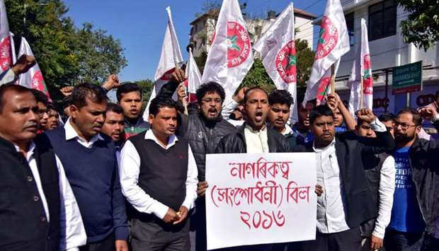 Activists from the All Assam Students Union (AASU) shout slogans during a protest