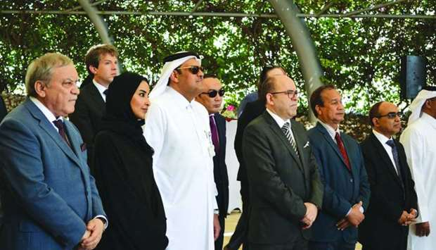 Russian ambassador Nurmakhmad Kholov joins other dignitaries at the tree-planting ceremony.