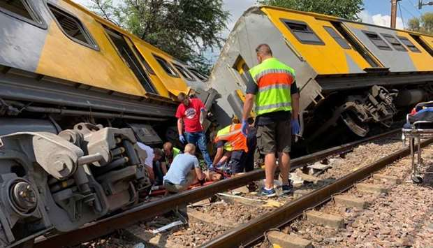 Emergency services are seen at the site of a train crash in Pretoria, South Africa. TWITTER/@ABRAMJE
