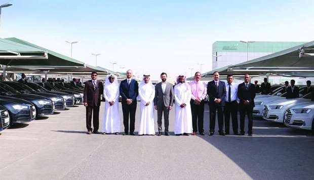 Khalid Nasser al-Hail, along with Ahmed Sharif and other Mowasalat and Q-Auto officials at the launc