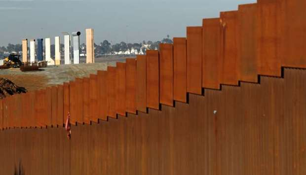 Border wall are seen behind the border fence between Mexico and the United States, in Tijuana